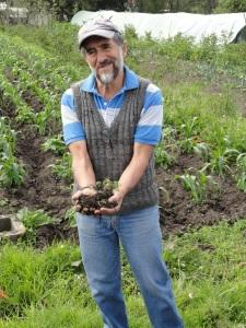 Pacho Gangotena showing what fertile soil looks like.